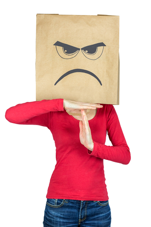 bitchy: Woman wearing  paper bag on head showing angry face making gesture of time out isolated on white background Stock Photo
