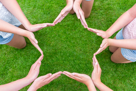 Arms of children with hands making starshape Stock Photo - 46427833