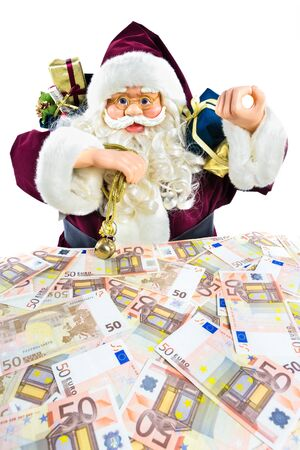 euro notes: Model of Santa Claus with presents and euro notes isolated on white background Stock Photo