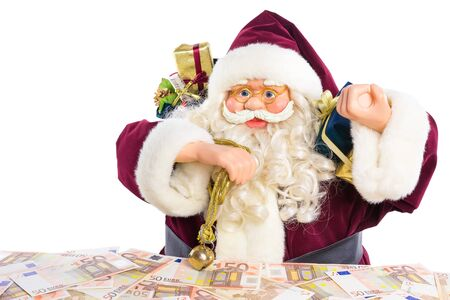 euro notes: Model of Santa Claus with gifts and euro notes isolated on white background