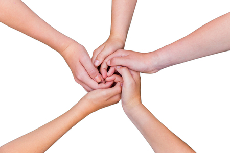combining: childrens arms with hands entwined on white Stock Photo