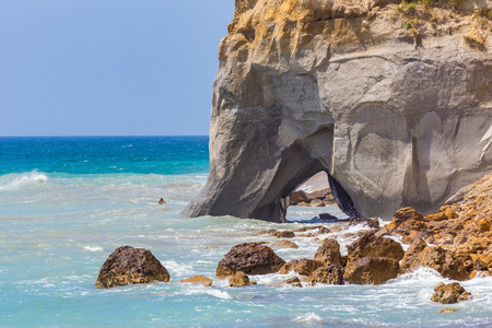 Rock with cave in sea at greek Kefalonia coast