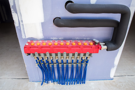 Construction with blue pipes for underfloor heating Stock Photo