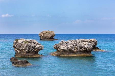 Three separate rocks offshore in blue greek ocean
