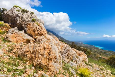 Orange rocks on mountain near coast in Kefalonia Greece