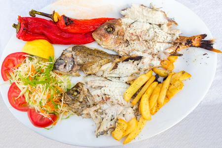 browns: Mediterranean menu fish fries and vegetables on plate