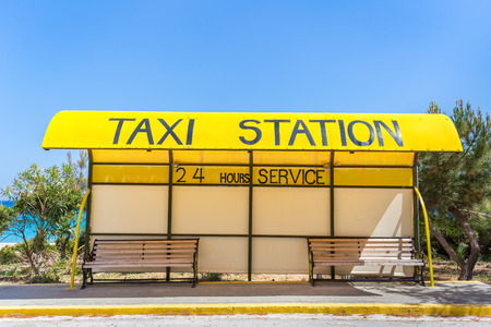 Yellow taxi station at coast in Greece Stock Photo