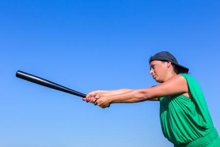 Dutch woman with baseball bat and cap strikes
