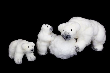animal figurines: Mother polar bear with children figurines on black background
