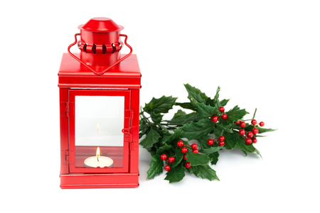Red lantern with tealight holly sprigs and berries