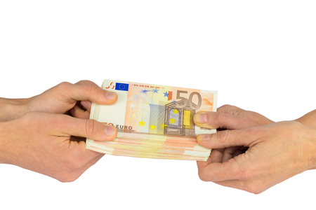 Hands pulling at pile of fifty euro notes isolated on white background