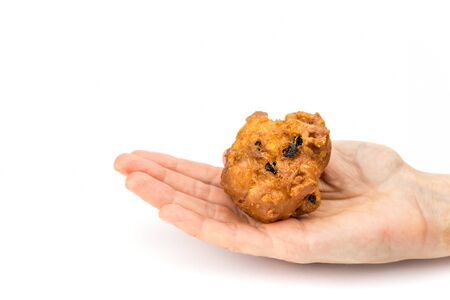Female hand palm showing fritter or oliebol isolated on white background Stock Photo