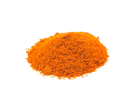 Heap of spice cayenne pepper powder isolated on white background