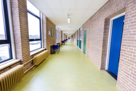 Long straight and empty corridor in secondary school building Standard-Bild