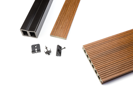 Brown composite decking plank with fastening material on white background Stock Photo