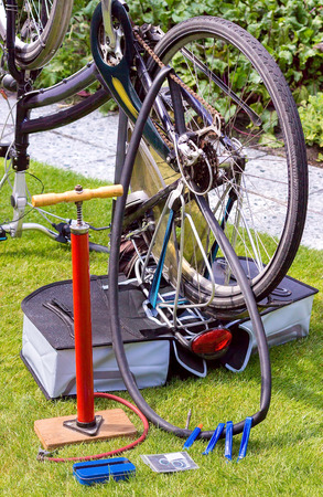 mounting holes: Bicycle upside down on grass outside for flat tire reparation
