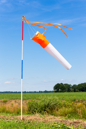 Wind meter in countryside with blue sky Stock Photo