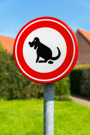 Traffic sign prohibited to let the dog shit here