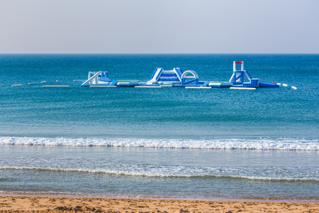 Floating playset on blue sea for holiday swimmers