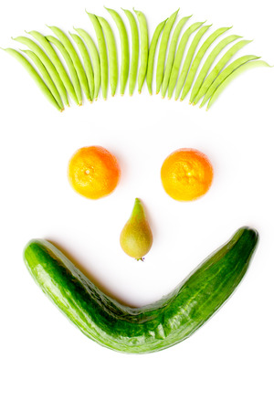 Head made of fruits and vegetables isolated on white background