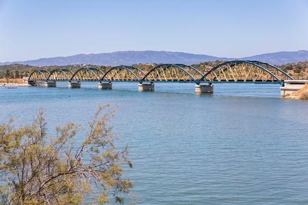 Railway bridge with arches over river in portuguese landscape Stock Photo