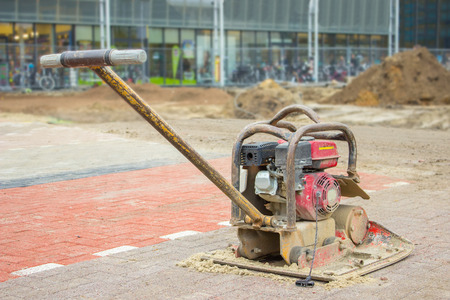 Vibratiing plate on new landscaped dutch parking space
