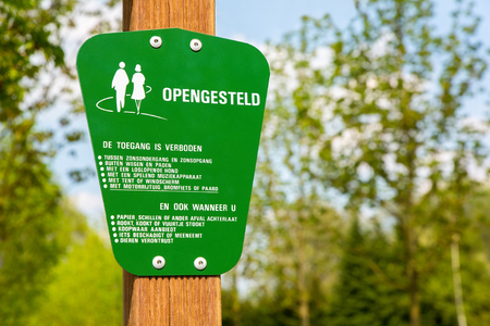 Green traffic sign for behaviour of dutch walkers in forest