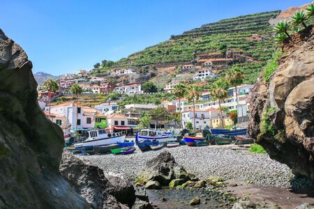 Portuguese Landscape with fishing boats and village on mountain Фото со стока - 131026813