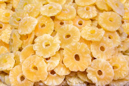 Heap of dry yellow pineapple slices for sale at market Фото со стока - 131026849