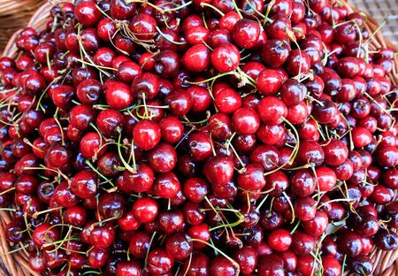 Many fresh red cherries in basket for sale at market Фото со стока - 131026904