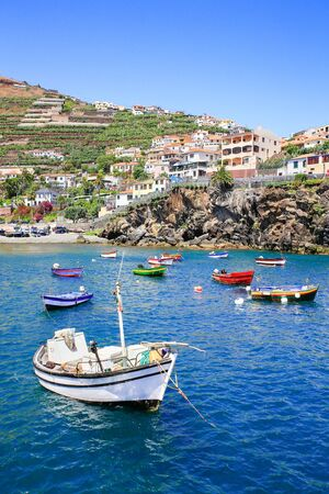 Landscape in Portugal with small fishing boats and village on mountain Фото со стока