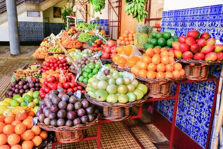 Market place with many colorful fresh fruits on Madeira in Portugal Фото со стока - 131026937