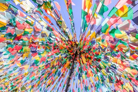 Converging lines with colorful flags as decoration for festivity in Portugal Фото со стока