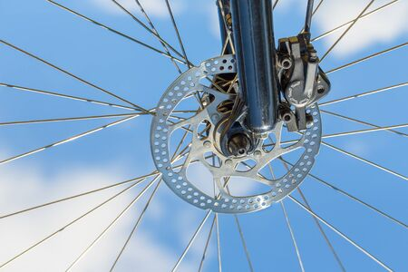 Mountanbike wheel with disc brake up in the blue sky
