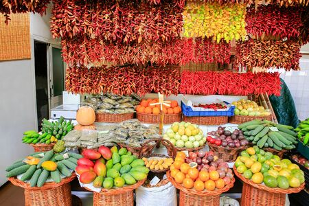 Market stall with many colorful fresh fruits on Madeira in Portugal Фото со стока - 131026985