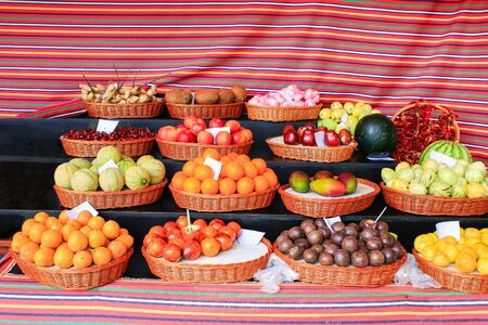 Market stall with several colorful fresh fruits on Madeira in Portugal