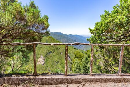 Look through wooden fence with abyss, valley and mountainds in Portugal Фото со стока - 131027129