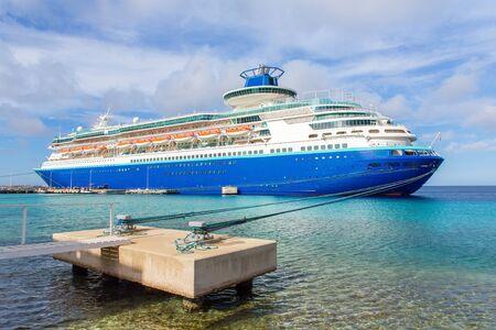 Large blue passenger ship  anchored on coast of Bonaire Фото со стока