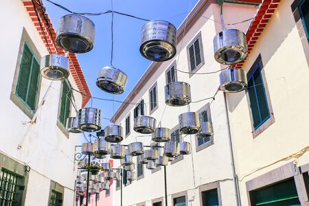 Decorated city street between white houses in Portugal