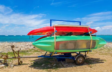 Trailer with canoes or kajaks on beach next to the sea on island Bonaire