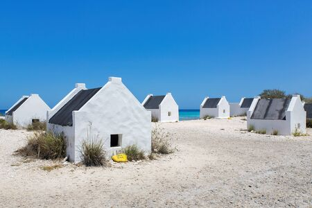 Group of white slave houses at the coast of Bonaire