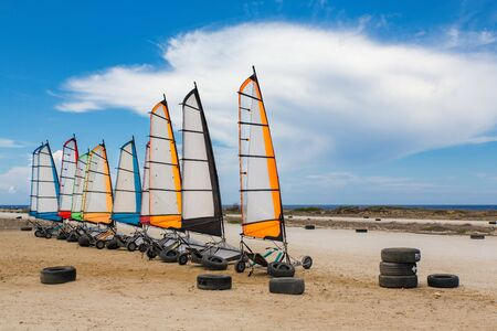 Race track on coast with sailing buggies in a row