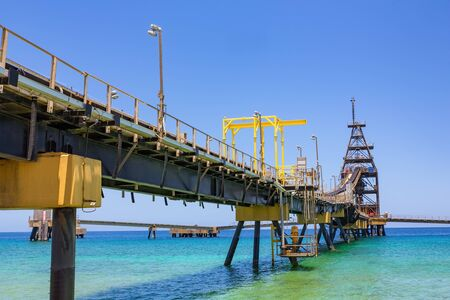 Conveyor belt for salt transportation  as pier in sea on Bonaire Stok Fotoğraf
