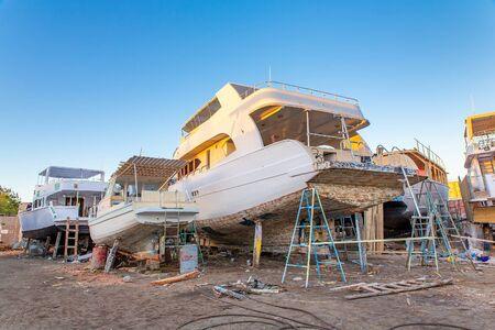 Pleasure boats under construction at shipyard in Egypt Reklamní fotografie