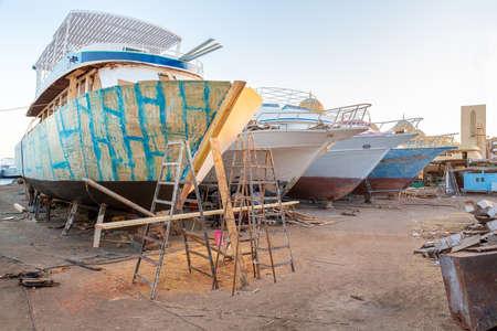 Group of pleasure boats under construction at shipyard in city Hurghada Egypt
