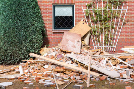 Renovations at european home with debris in garden