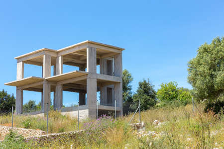 Unfinished concrete building in rural Kefalonia in Greece