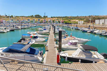 Port in Portugal with moored rows of pleasure boats at pier Reklamní fotografie
