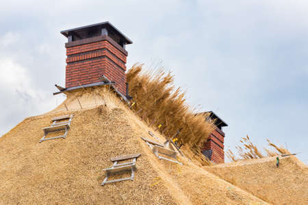 New thatched roof with two chimneys on dutch home Reklamní fotografie