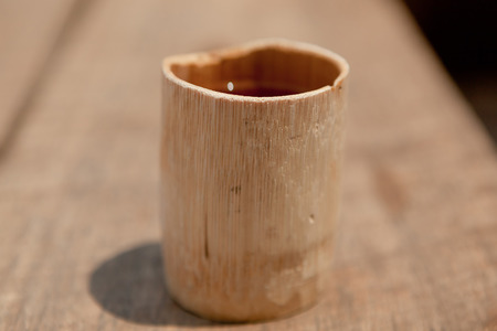 thee: A bamboo cup filled with thee